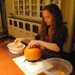 Photo of Charis removing pumpkin seeds for an S.A.T.gourmet blog post on baked pumpkin seeds.
