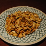 Photo of baked pumpkin seeds for blog post on S.A.T.gourmet.