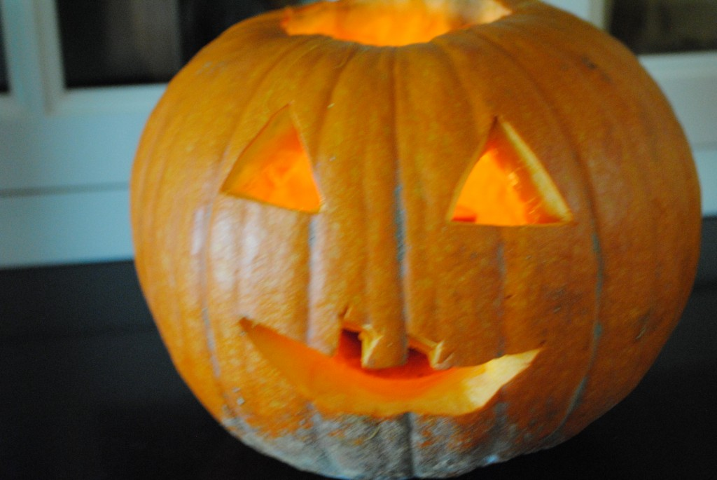 Photo of carved pumpkin for S.A.T. gourmet blog post on baked pumpkin seeds for Halloween