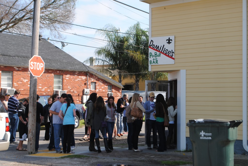 "photo of lining up at Domilise restaurant waiting to eat po-boy sandwich in New Orleans, part of post about Baton Rouge Advocate review of ""Cook Your Way Through THe S.A.T"""