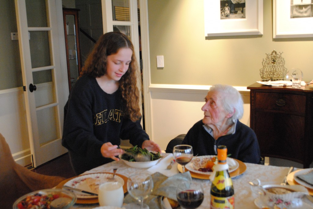 "Photo of Charis Freiman-Mendel, the S.A.T.gourmet and author of ""Cook Your Way Through The S.A.T."" serving her ninety eight year old great aunt dinner at Thanksgiving for post on Tranksgiving traditions New and Old"