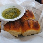 Photo of rolls and olive oil dipping sauce at Matunuck Oyster Bar, for a restaurant review by Charis Freiman-Mendel, author of Cook Your Way Through The S.A.T.