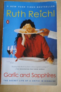 "Photo of front cover of book ""Garlic and Sapphires"" by Ruth Reichl for post by Charis Freiman-Mendel, author of ""Cook Your Way Through The S.A.T."", offering tips for learning standardized test vocabulary such as read, circle, lookup"