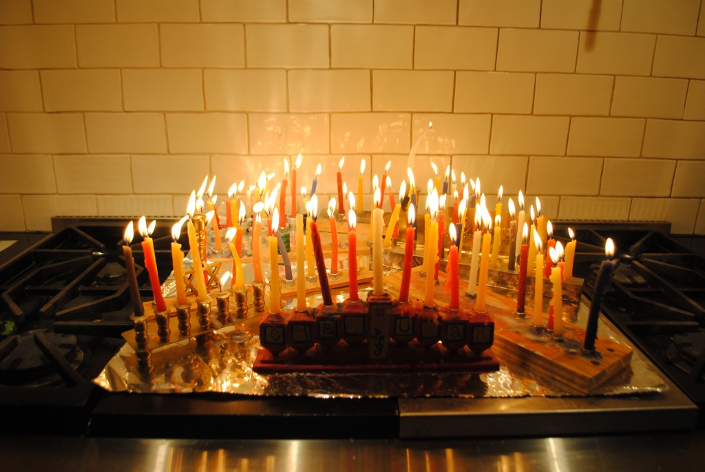 Charis Freiman-mendel, author of cook your way through the s.a.t., shows picture of Hanukkah lights for blog post on hanukkah apple honey cake recipe.
