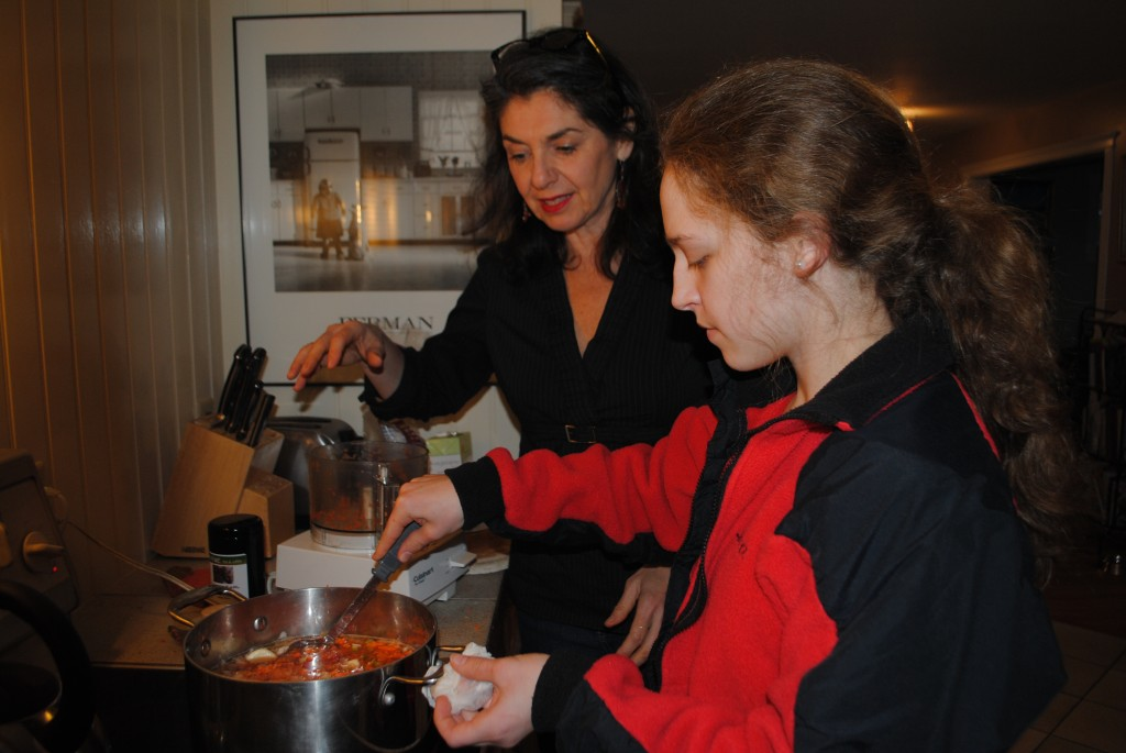 Photo of julie eisenberg janson and charis freiman-mendel with pot of lentil soup on cooking on for lentil soup post by charis freiman-mendel, author of cook your way through the s.a.t.