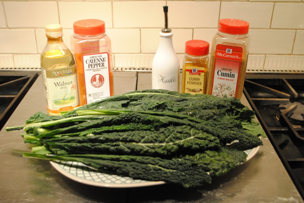 Photo of lacinato kale with two types of seasonings, walnut oil and cayenne pepper, or olive oil with curry powder and cumin, for blog post on superbowl superfood kale chips by charis freiman-mendel, author of cook your way through the s.a.t.