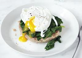 "Photo of poached eggs Florentine on biscuit for blog by charis freiman-mendel, author of ""cook your way through the s.a.t."""