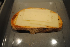 "Photo of swiss cheese on sourdough bread for blog on Recipe of ""Spanglish"" sandwich, for www.SATgourmet.com, a website by author of Cook Your Way Through The S.A.T., Charis Freiman-Mendel."