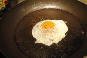 """Photo of a sunny-side up egg for blog on Recipe of """"Spanglish"""" sandwich, for www.SATgourmet.com, a website by author of Cook Your Way Through The S.A.T., Charis Freiman-Mendel."""