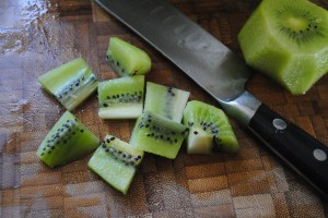 Photo of chopped kiwi for blog on www.SATgourmet.com of world's healthiest fruit bowl, written by Charis Freiman-Mendel, author of Cook Your Way Through The S.A.T.