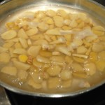 Photo of sliced ginger cooking in pan for Mother's Day blog on homemade ginger candy recipe by Charis Freiman-Mendel, author of Cook Your Way Through The S.A.T.