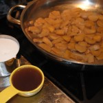 Photo of simmering ginger in saucepan with sugar and ginger water to be added, for Mother's Day blog on homemade ginger candy recipe by Charis Freiman-Mendel, author of Cook Your Way Through The S.A.T.